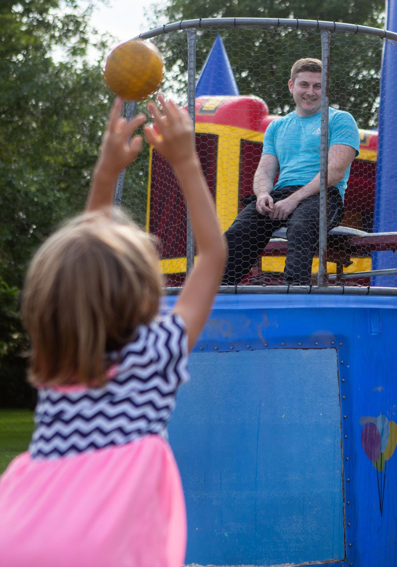 Jocelyn Hamilton throws the ball at the target to dunk Coleridge Police Chief Matt Monday during Community Day in Coleridge on Saturday. Hamilton was the first to dunk Monday during this celebration to welcome him to the village. The celebration also featured food and games for the entire family.
