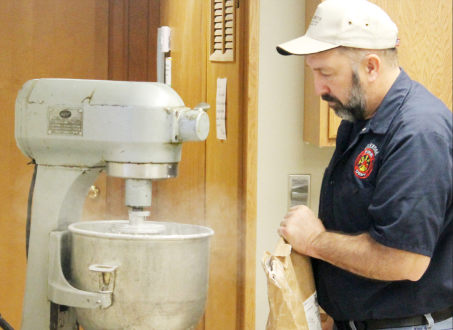 Mark Rose puts together a batch of pancake mix for the Firemen's Breakfast..
