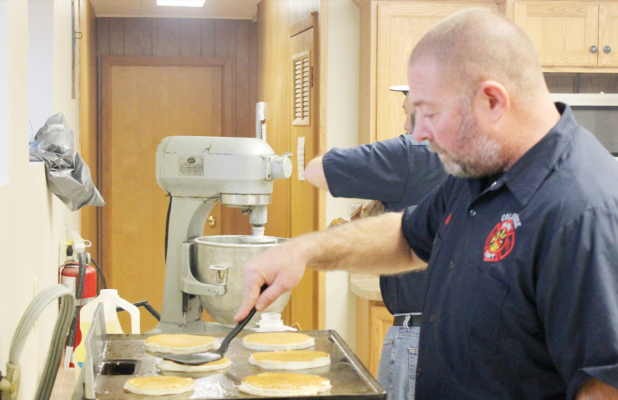 Kelly Hammer, member of the Coleridge Volunteer Fire Department, makes pancakes at Sunday's Fireman's Breakfast
