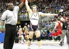 The referee raised Noah Scott's arm signalling victory in Saturday's State Championship match in Omaha. Scott became the 12th Randolph wrestler to earn a state title.