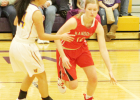 Carlie Nordhues moves the ball closer to the paint during action Friday at Wausa. The Lady Cards earned the L&C Conference win.