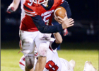 Randolph's Carter Schnoor breaks loose from a Plainview defender and heads downfield.