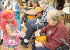 LaVern Acklie shares treats with trick-or-treater