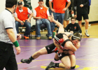 Noah Scott tries to keep his foe from escaping during action at the Battle Creek Wrestling Invite on Saturday.