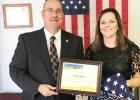 U.S. Dept. of Agriculture Rural Development State Director Karl Elmshaeuser presented Randolph City Clerk Kelsey Backer last week with a plaque as the City Clerk of the Year.
