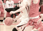 Randolph's Cindy Haselhorst drives the ball past a defender and toward the basket during Holiday Tournament action here.