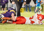 Randolph's Justin Haselhorst tries to stretch out for extra yardage during action in last week's regular season finale against Wausa. The Vikings won an offensive shoot-out to end the Cards' regular season at 6-2.