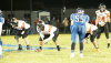 The Osmond Tigers (facing forward, with Anthony Heiman at far right) get set on the line during the playoff game against the Bloomfield Bees on Halloween night.