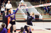 Wausa's Liz Johnson and Hartington's Evvie Krie both jump to deflect a ball at the net during action in their Sub-District game Monday night in Creighton. The Wildcats earned a 3-1 win to end Wausa's season.
